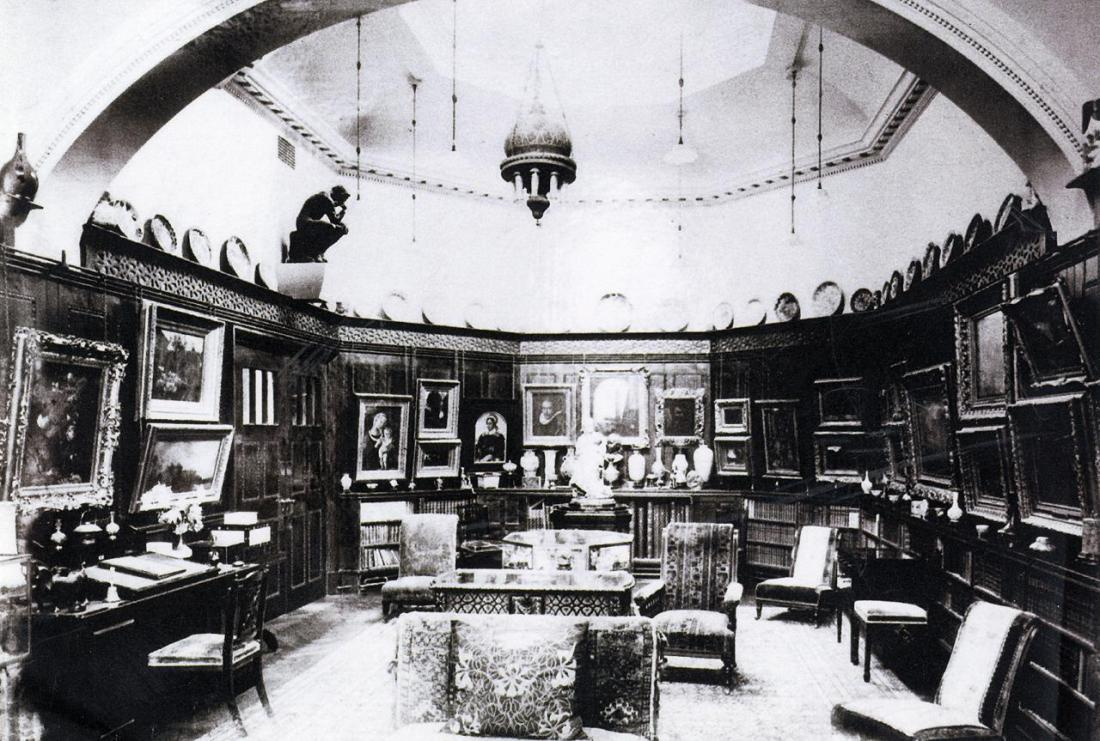 The earliest known photograph of our sculpture pictures it high on the wall of a domed white library ceiling, in the collection of Constantine Ionides