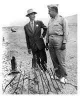 Robert Oppenheimer with General Leslie Groves at Trinity Site, July 1945.