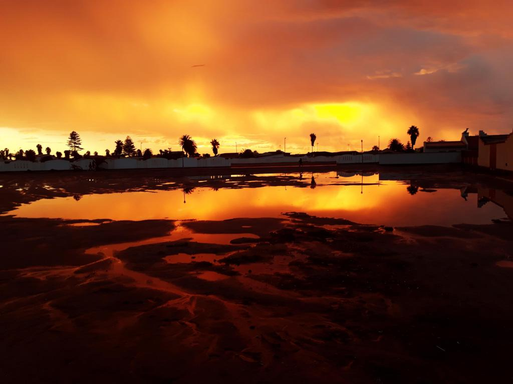 Sunset in Namibia, Walvisbay after the rain