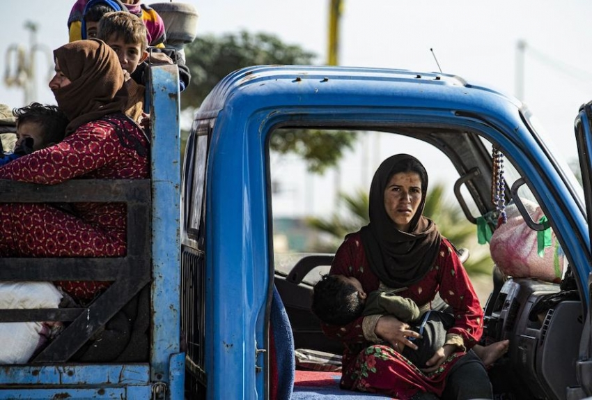 Syrian Arab and Kurdish civilians arrive in the city of Tal Tamr on October 15 2019 after fleeing the battle zone between Turkey-led forces and Kurdish fighters.